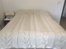Queen Size bedspread laced together in the center for easy cleaning - maybe!