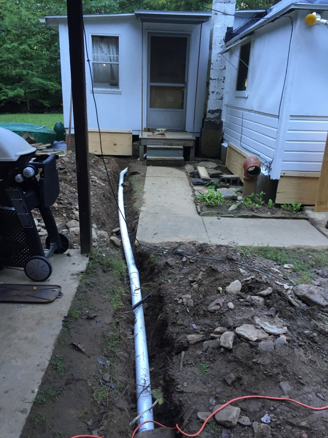 water line taped, wrapped and in pic from the well to the cabin